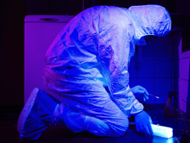 Forensic scientist in crime scene