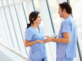 Male and female nurse discussing treatment